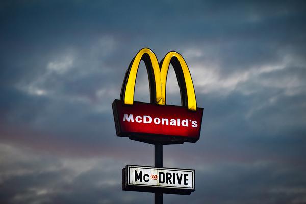 McDonalds Street sign golden arches