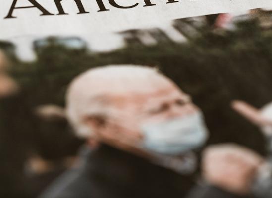 Biden masked Newspaper image Photo by Markus Spiske on Unsplash