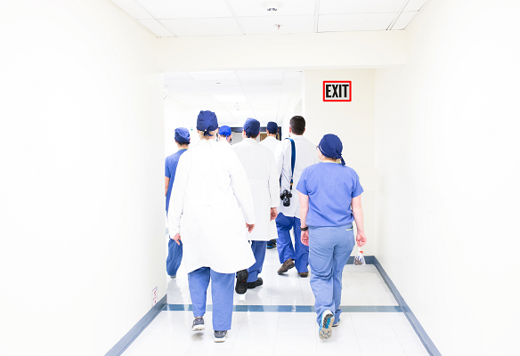 Health care nurses doctors walking away Original Photo by Luis Melendez on Unsplash