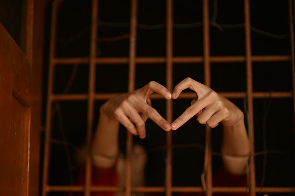 prison bars hands Jail heart Photo by Rajesh Rajput on Unsplash