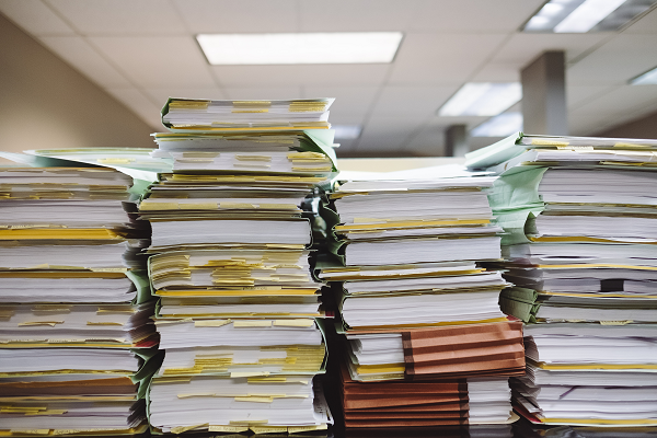 Bureaucracy rulemaking appaerwork red tape Photo by Wesley Tingey on Unsplash