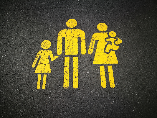 Family painted on pavement Photo by Sandy Millar on Unsplash
